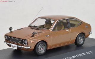 Toyota Starlet 1200 ST 1973 brown metallic diecast 1:43 IXO
